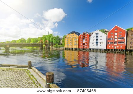 Summer view from Nidelva river on three main landmarks Trondheim Norway