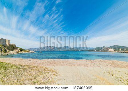 Cirrus clouds over Fortezza Vecchia beach Sardinia