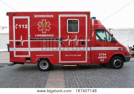LISBON PORTUGAL - CIRCA JUNE 2015: Fire brigade ambulance parked on main square (Praca do comercio)