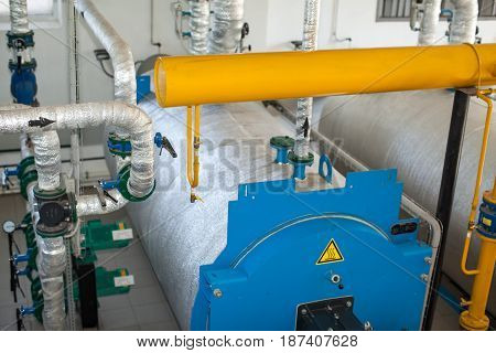 Modern boiler room equipment- high power boiler burner. Boiler room. Water heating. Power supply. Pipes in a boiler room. Isolation of pipes.