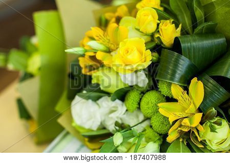 Green and yellow Flower composition on a table. Wedding decor. Beautiful bouquet of flowers.