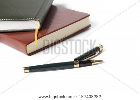 White notebook paper brown and black with pen on white background.office supplies