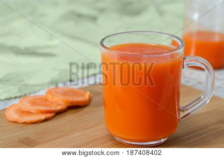 Fresh and delicious carrot juice in a glass Cup.