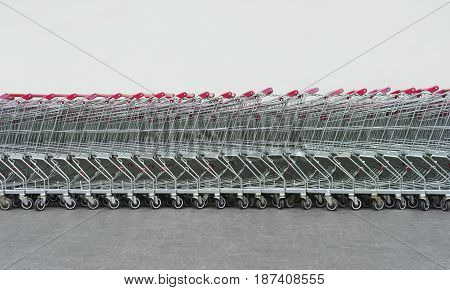 Row of shopping carts in supermarket wall
