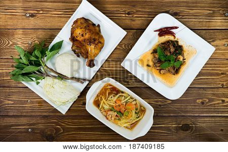 Spicy papaya salad grill chicken and spicy pork salad with sticky rice