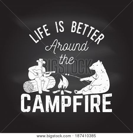 Life is better around the campfire on the chalkboard. Vector illustration. Concept for shirt or logo, print, stamp or tee. Vintage typography design with campfire, bear, man with guitar and forest silhouette.