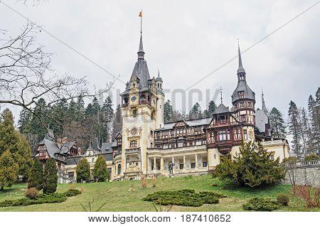 SINAIA, ROMANIA - APRIL 4, 2017: The Peles Castle from Sinaia Romania Carpathian Mountains.