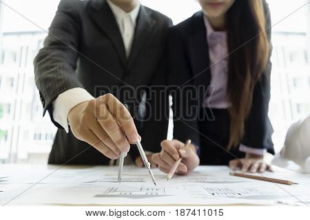 engineer drawing architecture project on blueprint in office engineering concept architecture concept soft focus vintage tone