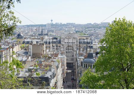 ParisFrance- April 30 2017: View of Paris from the top of the hill of Montmartre.Down the street there are pedestrians