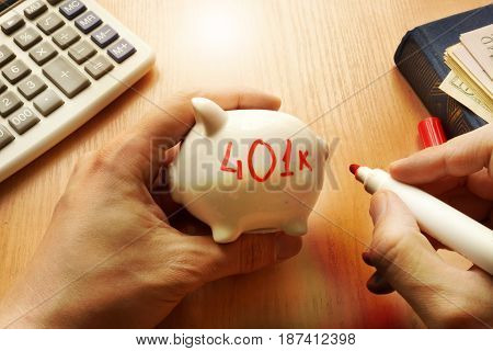 Piggy bank with word 401k. Retirement plan concept. poster