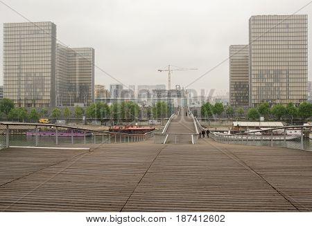 ParisFrance- May 062017: Pedestrians go by Simone de Beauvoir footbridge