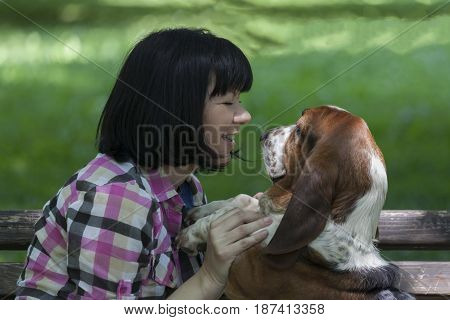 She Loves Dogs. Woman With A Dog Enjoying The Beautiful Day In Nature.