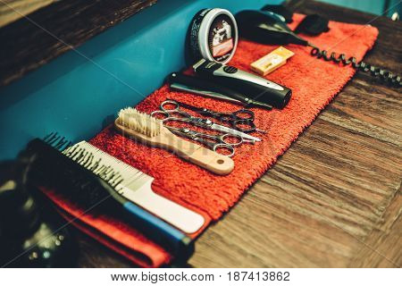 Men's Barber tools. Side view of barbershop tools lying on the wood grain