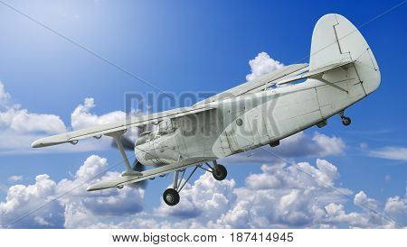 Biplane landing with cloudy sky on the background.