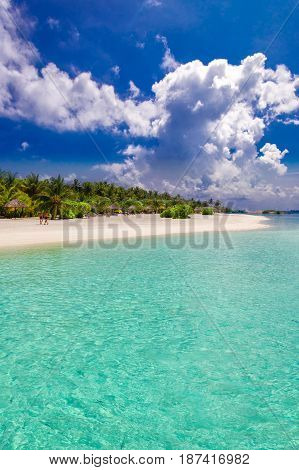 Tropical Island With Sandy Beach, Overwater Bungalows And Tourquise Clear Water