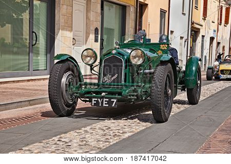 GATTEO, FC, ITALY - MAY 19: driver and co-driver on an old Alfa Romeo 8C 2300 Monza (1933) in historical classic car race Mille Miglia on May 19, 2017 in Gatteo, FC, Italy