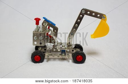Toy bulldozer. metal constructor isolated on white.