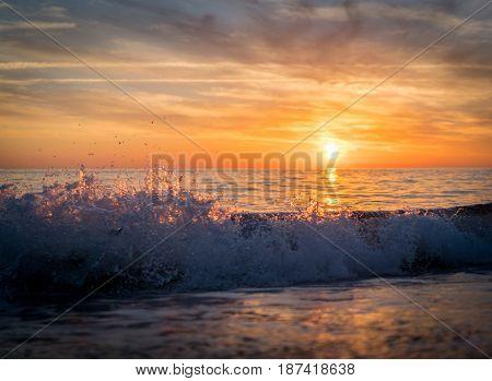 Silhouette of empty beach at sun set