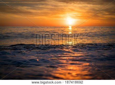 Silhouette of empty beach at sun set