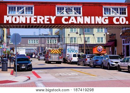 May 9, 2017 in Monterey, CA:  Canary Row which is now a tourist area including retail stores and restaurants and was once a district of seafood processing warehouses where tourists can currently enjoy shopping and restaurants taken in Monterey, CA