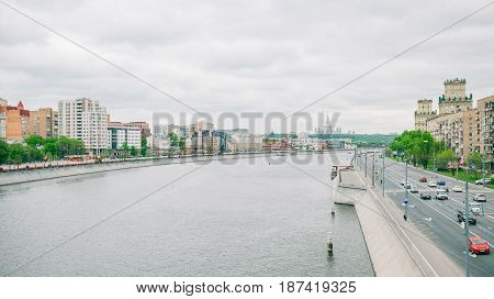 Moscow, Russia - May 21, 2017: Moscow river viewed from Bogdan Khmelnitsky bridge. Berezhkovskaya and Savvinskaya enbankments and Moscow State Unuversity