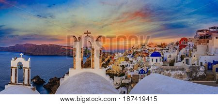 Amazing view with white houses in Oia village on Santorini island in Greece.