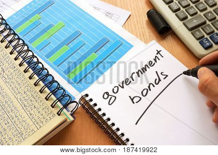 Government bonds written in a note. Trading concept.