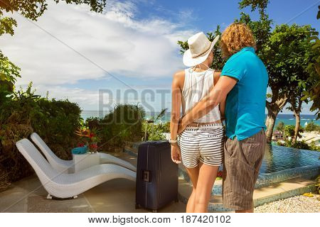 Couple tourist arrived in tropical resort