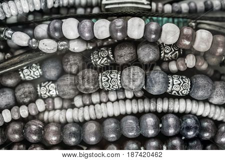Group of Ethnic wooden bracelets and necklaces close-up