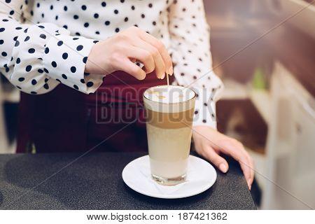 Woman Barista Making Latte Art At Cafe.