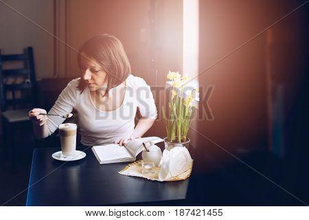 Cafe Customer Tasting Caffe Latte