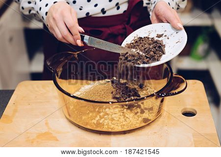 Cafe Employee Adding Pieces Of Chocolate To Bowl
