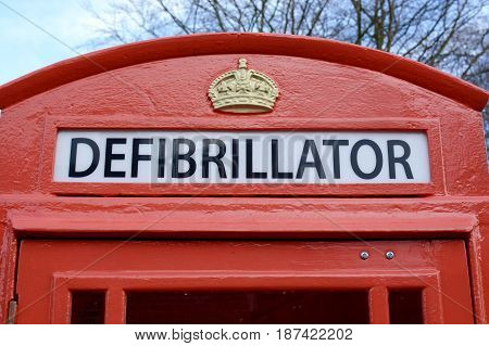 A Defibrillator being stored in a old style UK phone box for emergency use