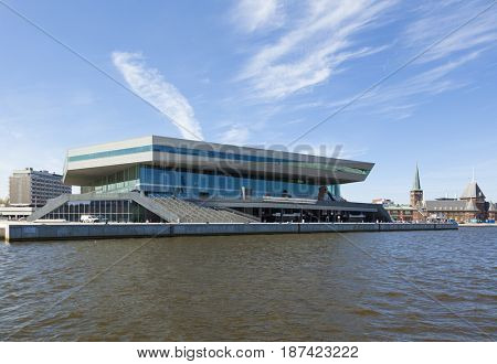 Aarhus, Denmark - May 2, 2017: Dokk1 building seen from the harbor. Dokk1 is a public library and culture center. The old customs house in background.