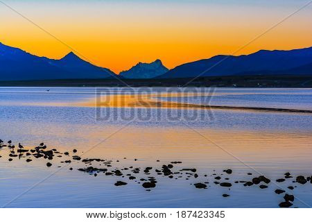 Gulf Almirante Montt, Puerto Natales, Chile - Pacific Ocean waters in Chile, Patagonia, Magallanes Region at sunset