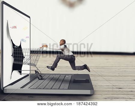 Businessman pushes a Shopping cart on the keyboard of laptop