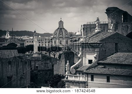 Rome Forum with ruins of historical buildings and rooftop view. Italy.