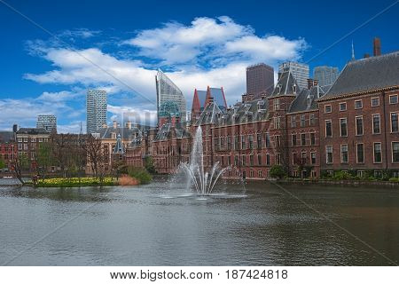 City center of The Hague Netherlands Europe. Binnenhof palace in Den Haag. The Dutch Parliament and Hofvijer Pond. Cityscape of The Hague. Skyline old and new buildings skyscrapers on background