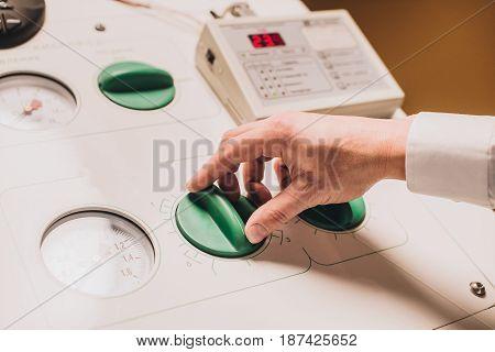 Hands Setting Up Medical Equipment
