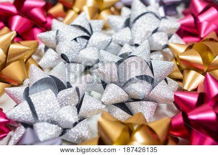 Macro Of Many Holiday Bows With Macro