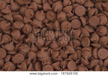 Sweet dark milk chocolate chips morsels background