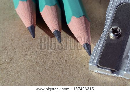 Craft paper background with pencil and eraser