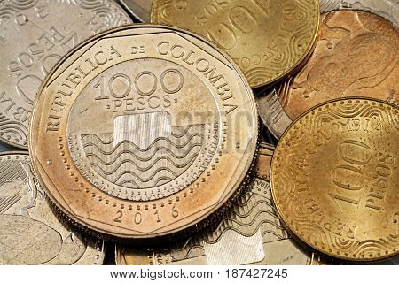 A macro close up shot of assorted Colombian coins