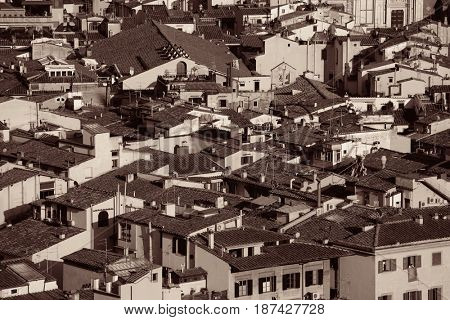 Roofs of old buildings black and white in Florence in Italy