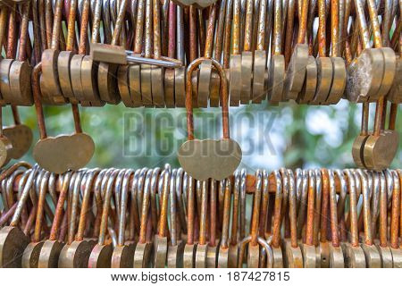 Love lockers on the bridge in China closeup photo