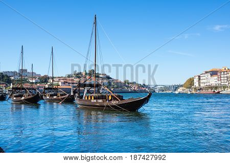 PORTO PORTUGAL - OCTOBER 21 2015: Typical wine boats in the Douro river in the historical center of Porto the second largest city in Portugal after Lisbon