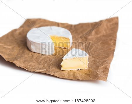 Fresh slice Camembert cheese natural on Kraft paper brown background. With clipping path
