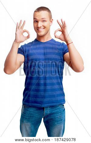 portrait of a young man showing OK sign  isolated against white background