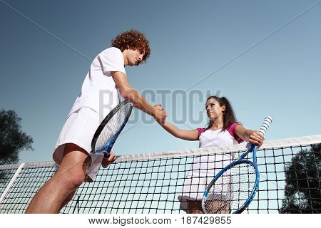 tennis players shaking hands fair play concept