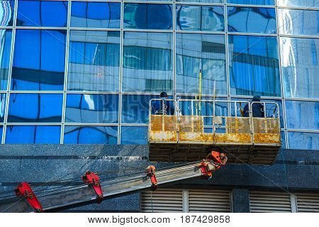 Moscow Russia 16 may 2017: workers clean a window at the business center